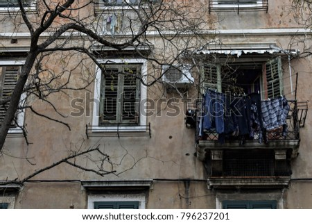 old house facade detail and laundry drying at balcony window  #796237201