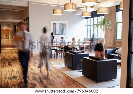 Business people at work in a busy luxury office space Royalty-Free Stock Photo #796346002