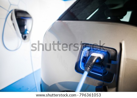 Close up image of the power socket of an electric car, charging. #796361053