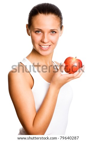 Portrait of an attractive young woman with an apple ahainst white background #79640287
