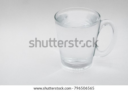 A glass of water with clear glass on white background.Pure water fill a glass.Mineral water refill in a cup. #796506565
