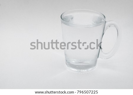 A glass of water with clear glass on white background.Pure water fill a glass.Mineral water refill in a cup. #796507225