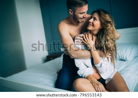 Attractive couple sharing intimate moments in bedroom #796553143