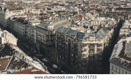 Panorama of houses and streets of Budapest, the facades of the houses and the road with cars in retro style, tilt-shift effect. #796581733