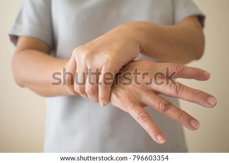 Parkinson's disease symptoms. Close up of tremor (shaking) hands of Middle-aged women patient with Parkinson's disease. Mental health and neurological disorders. #796603354
