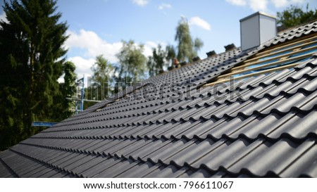 construction site roofing black tiles Royalty-Free Stock Photo #796611067