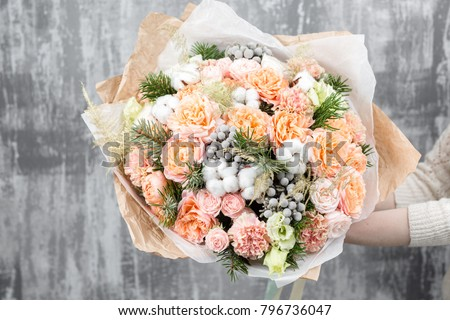 beautiful luxury bouquet of mixed flowers in woman hand. the work of the florist at a flower shop #796736047