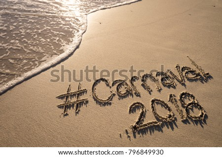 Modern message for Carnaval 2018 with a social media-friendly hashtag written on smooth sand beach
