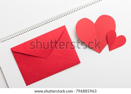 Red heart and love letter on the white sketchbook #796885963