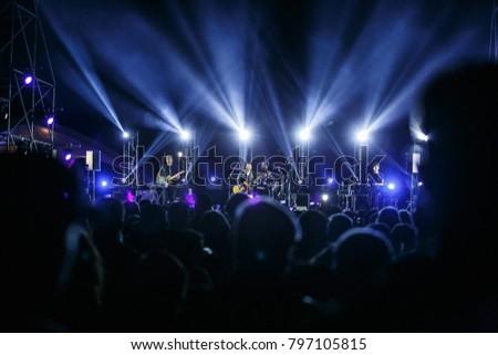 ODESSA,UKRAINE-21 AUGUST,2017:Famous pop singer Monatik singing on stage in bright blue concert lighting.Big popular music stage at summer festival #797105815