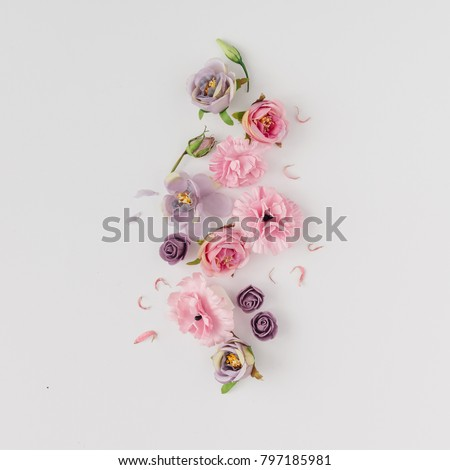 Creative layout made with pink and violet flowers on bright background. Flat lay. Spring minimal concept. #797185981
