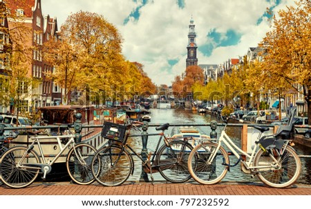 Bike over canal Amsterdam city. Picturesque town landscape in Netherlands with view on river Amstel. #797232592