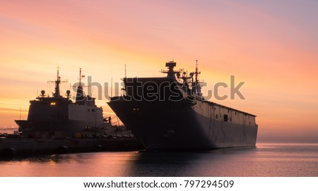 An aircraft carrier moored at port in a spanish naval base near to Cadiz. A huge military aircraft carrier at port. #797294509