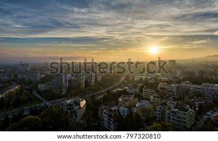 Cityscape of Varna at sunrise, Vibrant sky with fog. #797320810
