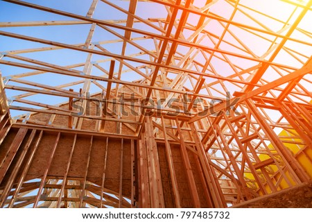 New home construction. build with wooden truss, post and beam framework. #797485732