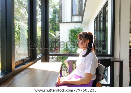 ?Nice girl sitting in relax emotion. #797505235
