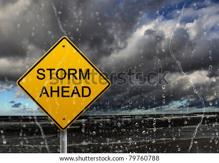 yellow warning sign of bad weather ahead against stormy sky #79760788