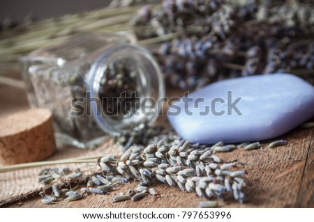 closeup of dried lavender bouquet and soap on wooden background #797653996