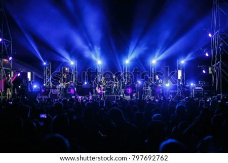 ODESSA,UKRAINE-21 AUGUST,2017:Guitarist plays solo part on big scene.Bright stage lighting on concert of famous ukrainian pop singer Monatik.Fantastic live performance at summer music festival outdoor #797692762