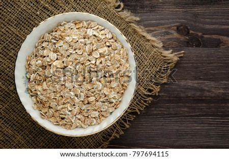 Oatmeal on a wooden table. Oatmeal top view. Healthy food #797694115