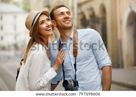 Travel. Couple Walking On Streets On Weekend Vacation, Looking And Enjoying Architecture. Happy Young Man And Beautiful Smiling Woman Traveling And Sightseeing City Attrcations. High Quality Image. Royalty-Free Stock Photo #797698606