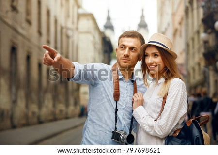 Travel. Couple Walking On Streets On Weekend Vacation, Looking And Enjoying Architecture. Happy Young Man And Beautiful Smiling Woman Traveling And Sightseeing City Attrcations. High Quality Image. Royalty-Free Stock Photo #797698621