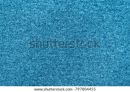 Bright blue seamless generic carpet texture shot from above. #797804455