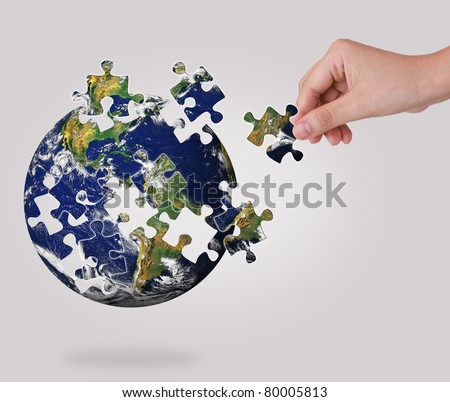 Business concept with a hand building puzzle globe #80005813