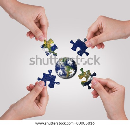 Business concept with a hand building puzzle globe #80005816