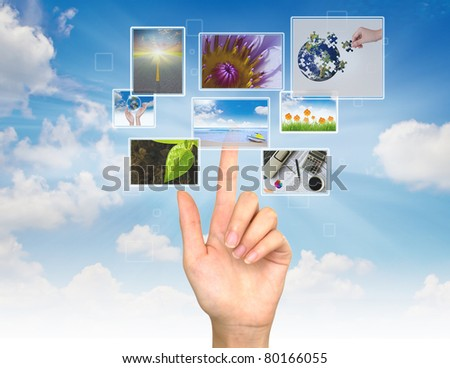 Hand touches the flow of images #80166055