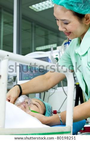 Portrait of woman patient receiving artificial ventilation in hospital #80198251