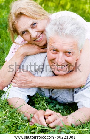 happy old couple playing at the nature #80221081