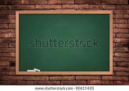 Green blackboard on old wall background