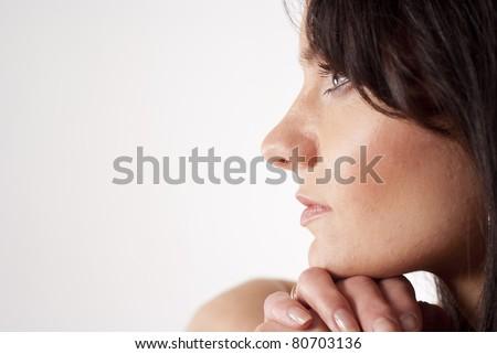 portrait of a beautiful woman posing on white #80703136