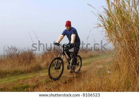 biker in action in winter with a lot of cold #8106523