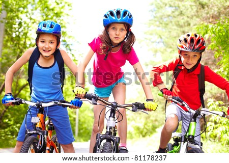 Portrait of three little cyclists riding their bikes #81178237