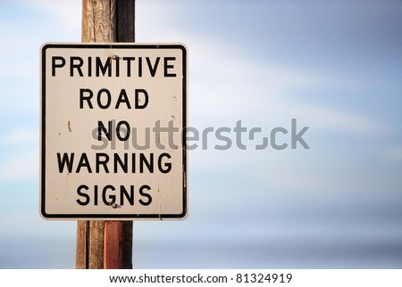 A warning sign warning that there are no warning signs.  A business metaphor for moving into uncharted waters, trying something that has never been tried before, or a leap of faith.
