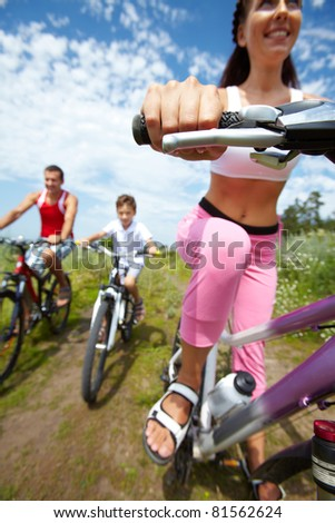 Family of three cycling outdoors #81562624