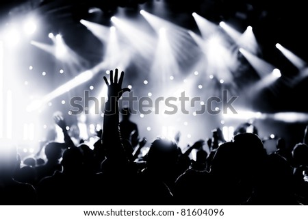crowd cheering at a live music concert #81604096