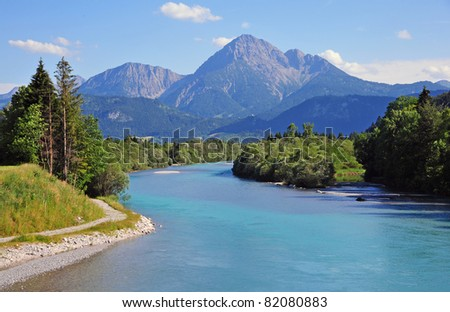 River of turquoise blue with mountains as background