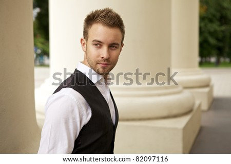 Portrait of a cheerful young businessman #82097116