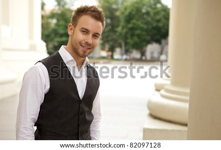 Portrait of a cheerful young businessman #82097128