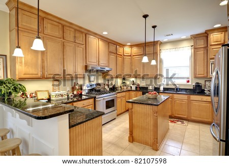 beautiful upscale kitchen with maple cabinets #82107598