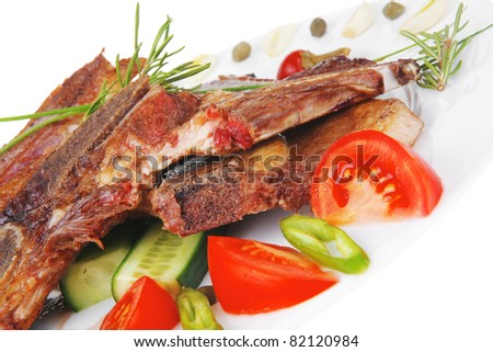 red beef meat steak on white plate with green hot pepper and tomatoes isolated  over white background #82120984