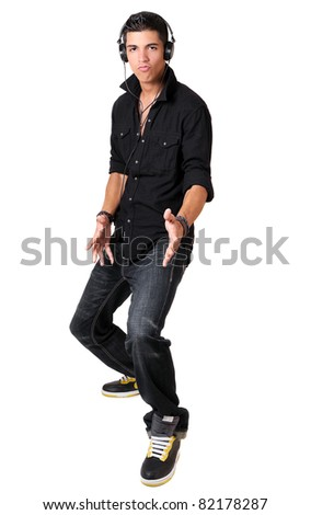 Young man dancing and listening to music with headphones #82178287