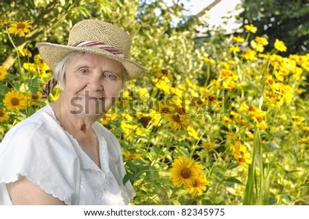 Older woman in flowers. #82345975