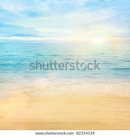 Beautiful sea summer or spring abstract background. Golden sand beach with blue ocean and cloudscape and sunset in the back. #82354534