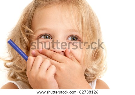 Laughing little girl covers her mouth with her hands and holding a pencil in her hand close-up on  white background #82738126