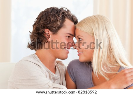 Young couple looking at each other while smiling #82818592