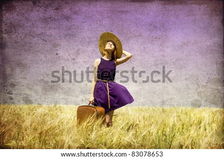 Lonely girl with suitcase at country. Photo in old color image style. #83078653